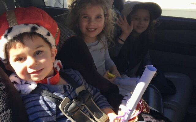 Zehnwirth family ride in the Purim Crawl.