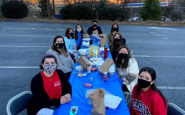 Students participate at an outdoor Shabbat event hosted by UGA Hillel.