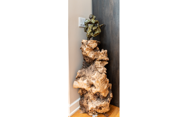 "Aaron's ""L'Chaim"" sculpture sits atop a dramatic unfinished burl base. Photos by  Duane Stork"