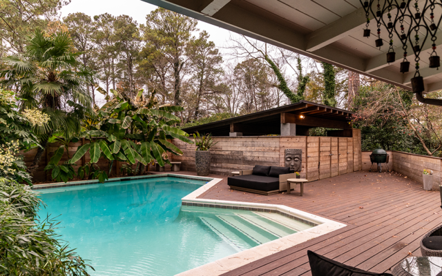 Peaceful view outside of pool and deck area. The heated pool is secluded behind the newly renovated wood fence.