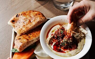 Photo by Angie Webb // Hummus comes in three varieties. Baum said the secret is pinching the chickpeas to assure softness.