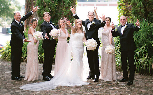 Photos by Laura Stone Photo // The couple share smiles with their wedding party in the Summerour courtyard.