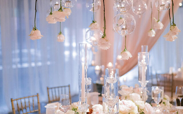Photos by Laura Stone Photo // Guests dined under floral chandeliers and cascading flowers suspended from the ceiling.