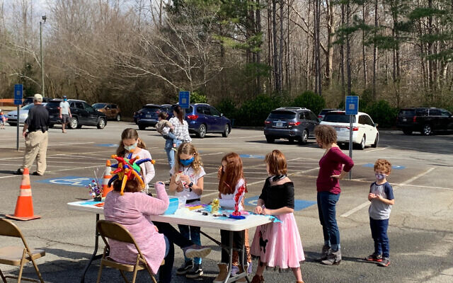Celebrations in the parking lot of Congregation Beth Shalom.