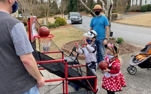 The carnival games at the Coleman home included basketball.