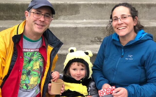 Yonit Shai Meisel, the bee, enjoys a snack. She is pictured here with her parents Jeremy and Ditza Meisel.