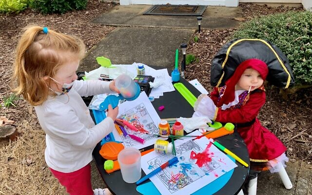 Shira Blake and Cece Birbrager coloring at the Blake home, a host home with a pirates theme.