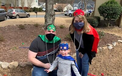 This superhero family are Ryan, Nathan and April Basler.