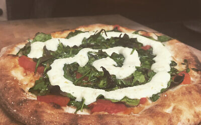 Gardener Pizza: Ricotta, lemon, garlic, spinach and tomato make for an artsy pie.