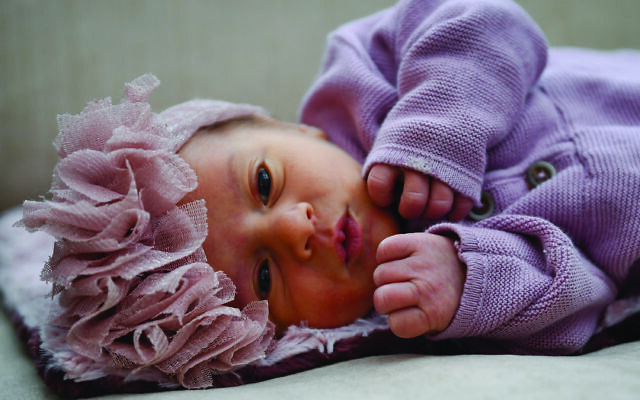 Lyla Rose was peaceful in her stylish headband.
