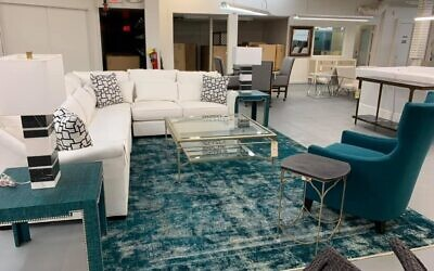 Herckis says that Persian and traditional rugs are stuffy and outdated.  Shown is a transitional updated look with a pop of color.