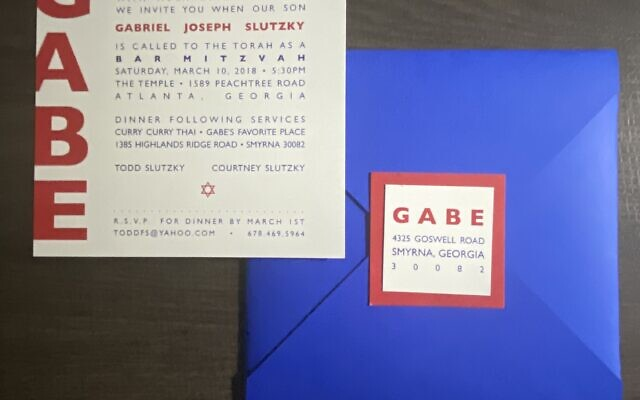 A bold red, white and blue bar mitzvah invitation that coordinates with a sticker that seals the envelope was designed by Paces Papers by Jackie.