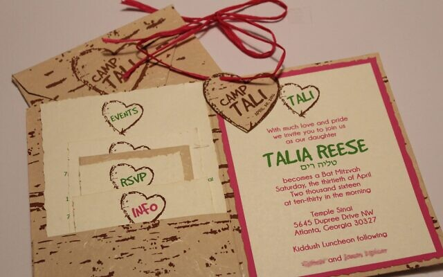 Using handmade paper that looks like wood, Zusmann incorporated a camp theme for a bat mitzvah invitation.