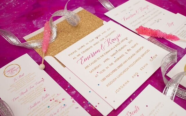 Two sisters share the bat mitzvah invitation designed by Zusmann.