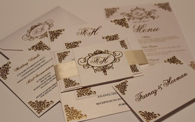 Zusmann used rolled gold foil and raised black ink when designing this wedding invitation.