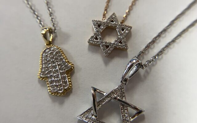 In-house jewelry designers at H&A International Jewelry create necklaces appropriate for bat mitzvah gifts.