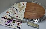 The challah board and knife, along with an applique challah cloth, make a meaningful wedding gift to last a lifetime, available at Judaica Corner.