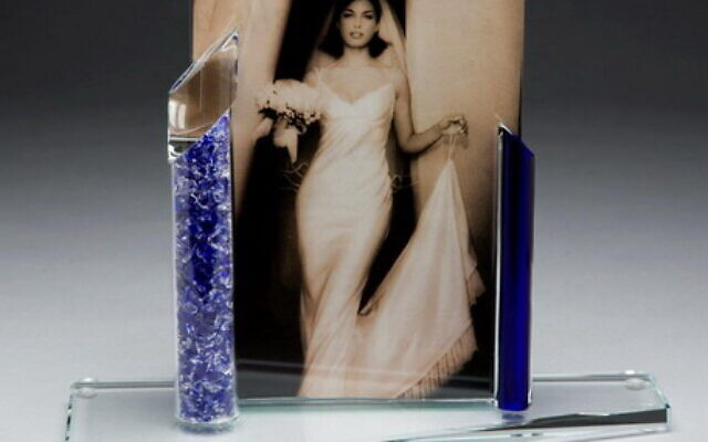 A picture frame for a bride that incorporates Shardz (broken vessel)  can be ordered through Fragile as a wedding gift.
