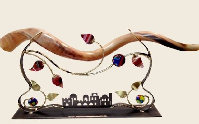 An authentic ram's horn shofar imported from Israel sits on a stand by artist Gary Rosenthal at Judaica Corner.