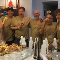 Marshall Duke, Andy Deutsch, Paul Wolpe, Eric Singer, Michael Robinowitz, and Zamir Norry in Chrayn Gang T-shirts pose with horseradish roots and plenty of vinegar.