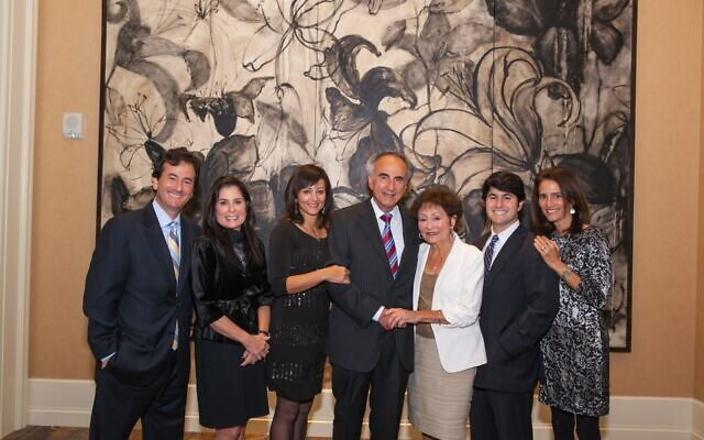 Perry and Shirley Brickman, center, honored by Israel Bonds in 2012, pictured here with son and daughter-in-law Jeff and Susan, daughter Lori, grandson Joseph and daughter Teresa.