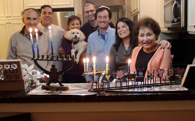 Celebrating Chanukah last year were Perry Brickman, Jason Morse, Lori Freeman (holding Cody), Jeff and Susan Brickman, and Shirley Brickman.