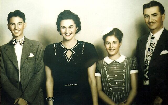Perry's bar mitzvah photo with his family: Perry, mother Ida, sister Rita, and father Myer.