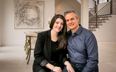 Photography by Duane Stork // Narissa and Dan Bonnet were hands on in engineering a well thought out 8,200-square-foot three-level contemporary house in Sandy Springs. The couple is seen here in the dining room.
