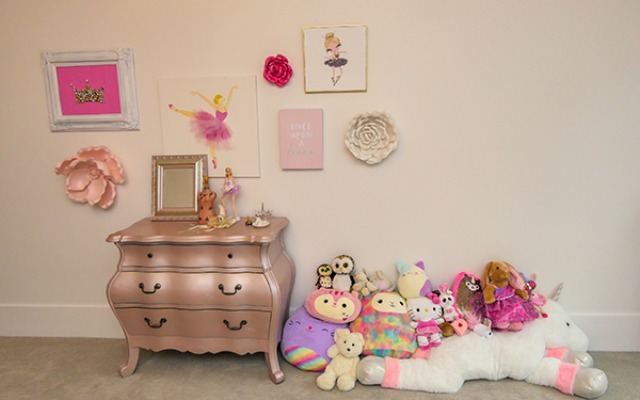 Photography by Duane Stork // Pretty in pink girl's bedroom has pearlized furnishings.