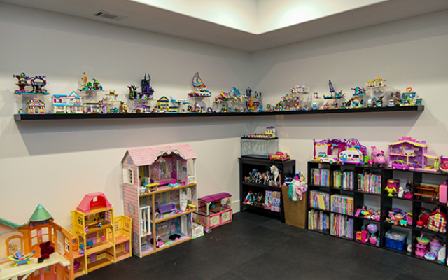 Photography by Duane Stork // The playroom has space for Lego displays and adjoins the art room.