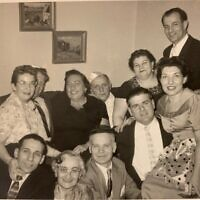 The children of Jacob and Frida Klein and their spouses in the 1950s.  My father is wearing a white kippah with my mother to his right.