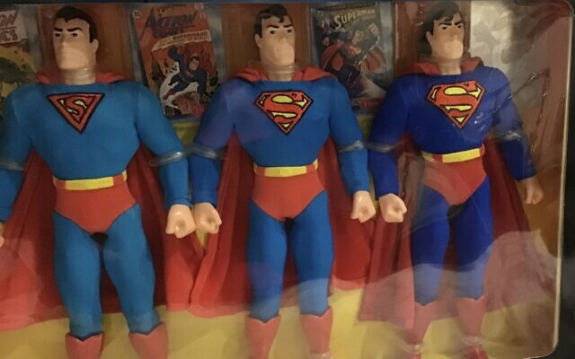 Items from Robkin's valuable collection of Superman from the '40s, '70s and '90s accompanied by comic books.