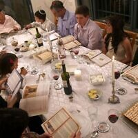 A family during a Passover seder. (Nati Shohat/Flash 90)