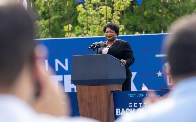 Former gubernatorial candidate Stacey Abrams speaks at a drive in rally for President Biden celebrating his 100 days in office, in Duluth, Georgia on April 29th, 2021// Nathan Posner for the AJT