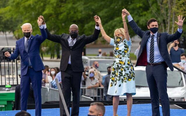 President Joe Biden and First Lady Dr. Jill Biden , alongside Senators Jon Ossoff and Raphael Warnock, are seen at a drive in rally for the President celebrating his 100 days in office, in Duluth, Georgia on April 29th, 2021. // Nathan Posner for the AJT
