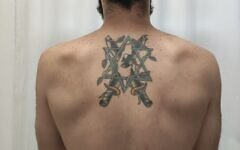 The back tattoo of David Eisenberg, a Sandy Springs native now living in Israel, pays homage to Israel: a Star of David, crossed swords with olive branches all intertwined.
