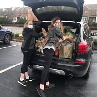 Allison Tanenbaum and Cyndi Sterne load sandwiches that they collected.