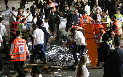"""Israeli rescue forces and Police near the scene after a stand collapsed wounding dozends during the celebrations of the Jewish holiday of Lag Baomer on Mt. Meron, in northern Israel on April 30, 2021. Photo by David Cohen/Flash90 *** Local Caption *** ל""""ג בעומר לג בעומר אסון קריסה במה מתים אנשים  חסידים חרדים חג הר מרון הר מירון"""