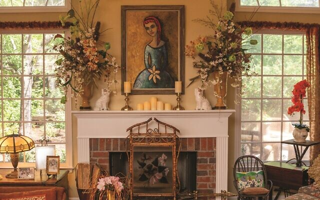 Howard wanted her living room to evoke a lodge atmosphere.  The fireplace painting is by Peggy Ellman.