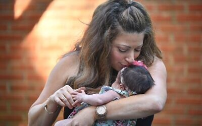 Allison Budnick with her daughter Mila, who was born as a result of an embryo transfer.
