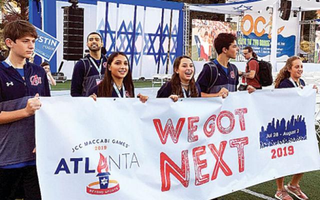 At the 2018 opening ceremonies, Atlanta athletes Jake Francombe, Jordan Starr, Hailey Rubin, Jake Powers, and Barri Seltz carry a banner showcasing Atlanta as the next year's host.