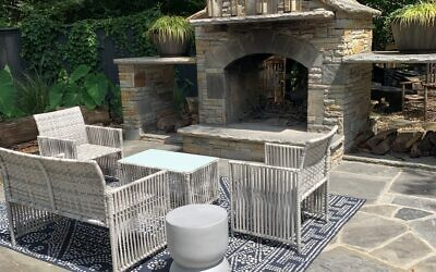 A stone firepit welcomes s'mores-making and small gatherings at Lisa and Zach Lazarus' home.