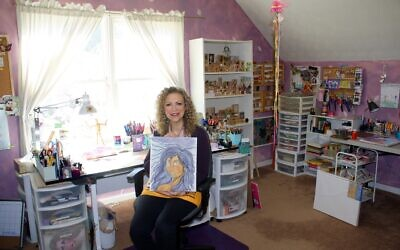 Terry Segal in her art room with colorful pens, pencils, markers, glitter and empty tea and chocolate canisters repurposed to hold art supplies.