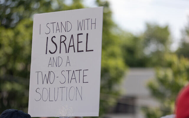 Nathan Posner for the AJT//  An Israel supporter holds up a sign in support of Israel and a two-state solution at a pro-Israel rally outside the Israeli consulate in Atlanta.