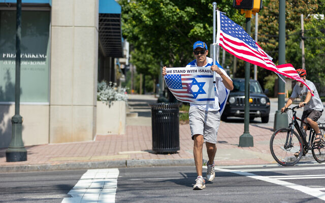 Nathan Posner for the AJT//  A pro-Israel supporter arrives at a rally in support of the Jewish state.
