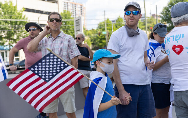 Nathan Posner for the AJT// A father and son wait for a pro-Israel rally to start outside of the Israeli consulate.
