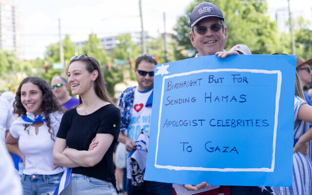 Nathan Posner for the AJT//  A man holds a sign before a pro-Israel rally in Atlanta.