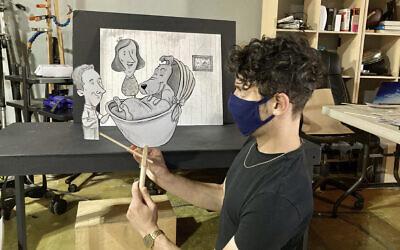 Jake Krakovsky manipulates puppets made by Ryan Bradburn.