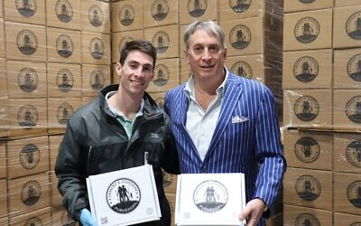 Ben and Kirk Halpern display Farmers & Fishermen Purveyors' delivery boxes at their headquaters.