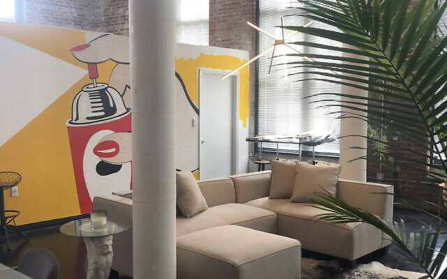 """Jordan spent months painting murals for his own interior like a Lichtenstein-like """"Spray"""" drawing, amidst live plants."""